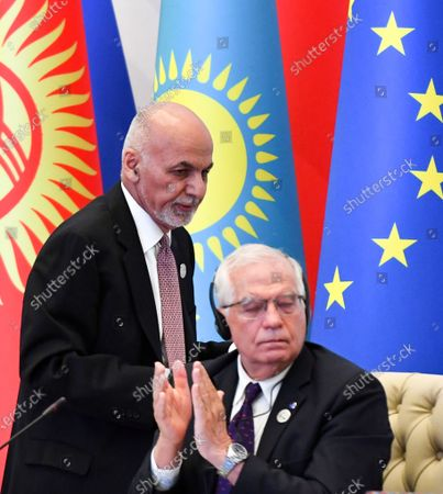Stock Photo of Representative of the EU for Foreign Affairs and Security Policy, Josep Borrell, bottom, applauds as Afghanistan's President Ashraf Ghani, walks past at the Central and South Asia 2021 conference in Tashkent, Uzbekistan