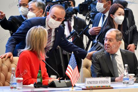 Stock Image of Russian Foreign Minister Sergey Lavrov, right, Turkish Foreign Minister Mevlut Cavusoglu, center, and U.S. Homeland Security Advisor Elizabeth Sherwood-Randall talk to each other during the Central and South Asia 2021 conference in Tashkent, Uzbekistan