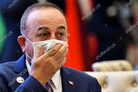 Turkish Foreign Minister Mevlut Cavusoglu reacts as he attends the Central and South Asia 2021 conference in Tashkent, Uzbekistan