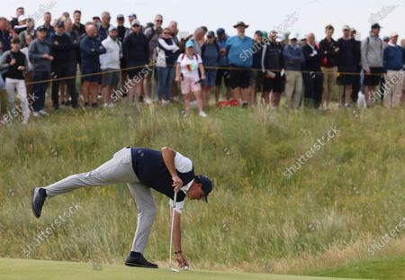 United States' Phil Mickelson places his ball on his mark on the 7th green during the second round of the British Open Golf Championship at Royal St George's golf course Sandwich, England