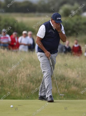 United States' Phil Mickelson reacts after failing to hole out during the second round of the British Open Golf Championship at Royal St George's golf course Sandwich, England
