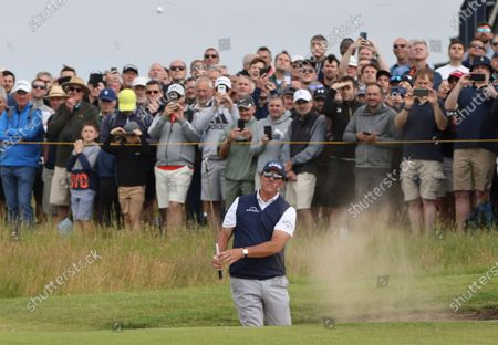 United States' Phil Mickelson plays out of a bunker on the 1st hole during the second round of the British Open Golf Championship at Royal St George's golf course Sandwich, England