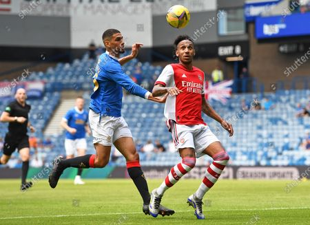 Pierre-Emerick Aubameyang of Arsenal and Kemar Roofe of Rangers