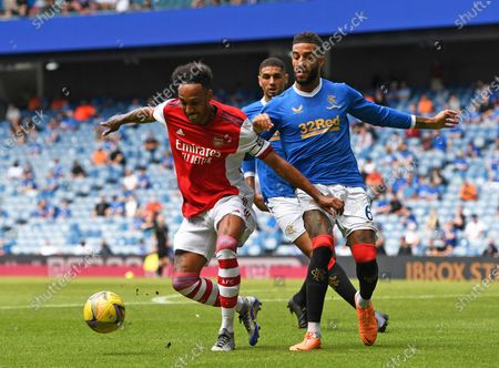Pierre-Emerick Aubameyang of Arsenal and Connor Goldson of Rangers