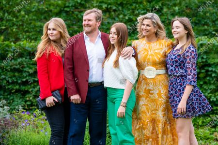King Willem-Alexander and Queen Maxima of the Netherlands with their daughters Princess Amalia, Princess Alexia and Princess Ariane during the annual summer photo session of 2021 at Huis ten Bosch Palace in The Hague.