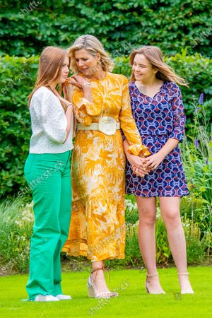 Queen Maxima of the Netherlands with Princess Alexia and Princess Ariane during the annual summer photo session of 2021 at Huis ten Bosch Palace in The Hague.