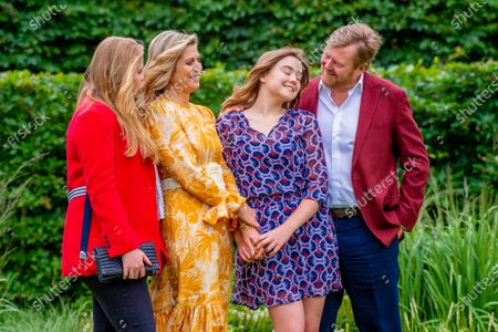 King Willem-Alexander and Queen Maxima of the Netherlands with their daughters Princess Amalia and Princess Ariane during the annual summer photo session of 2021 at Huis ten Bosch Palace in The Hague.