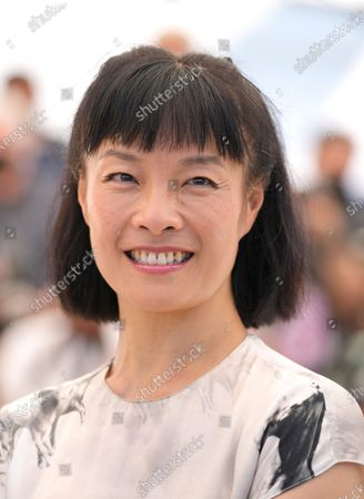 Mira Wang poses for photographers at the photo call for the film 'New Worlds: The Cradle of Civilization' at the 74th international film festival, Cannes, southern France