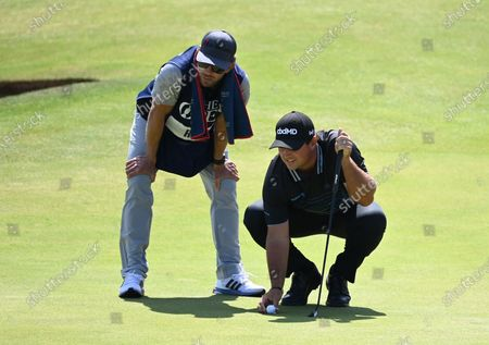 Patrick Reed of the US lines up his putt on the sixth hole during the 2nd round of The Open 2021 golf championship at Royal St George's golf course in Sandwich, Kent, Britain, 16 July 2021.