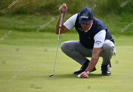 Phil Mickelson of the US places his ball during the 2nd round of The Open 2021 golf championship at Royal St George's golf course in Sandwich, Kent, Britain, 16 July 2021.