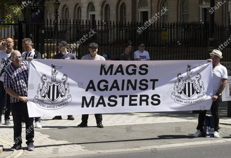 Stock Image of Newcastle fans protesting at Downing Street.Fans are staging a protest in the capital to back calls from would-be buyer Staveley and club owner Mike Ashley for transparency in the takeover arbitration process.The Public Investment Fund, Saudi Arabia's sovereign wealth fund, withdrew their backing for a proposed £300million deal last summer after the Premier League failed to make a timely decision on the deal.However, Ashley is attempting to resurrect the deal through arbitration - and he has Staveley's full support.