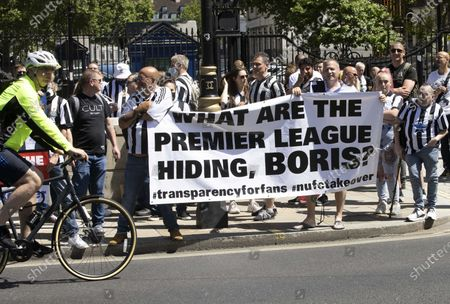 Stock Photo of Newcastle fans protesting at Downing Street.Fans are staging a protest in the capital to back calls from would-be buyer Staveley and club owner Mike Ashley for transparency in the takeover arbitration process.The Public Investment Fund, Saudi Arabia's sovereign wealth fund, withdrew their backing for a proposed £300million deal last summer after the Premier League failed to make a timely decision on the deal.However, Ashley is attempting to resurrect the deal through arbitration - and he has Staveley's full support.