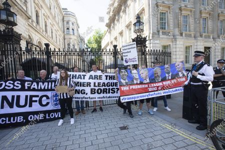Stock Picture of Newcastle fans protesting at Downing Street.Fans are staging a protest in the capital to back calls from would-be buyer Staveley and club owner Mike Ashley for transparency in the takeover arbitration process.The Public Investment Fund, Saudi Arabia's sovereign wealth fund, withdrew their backing for a proposed £300million deal last summer after the Premier League failed to make a timely decision on the deal.However, Ashley is attempting to resurrect the deal through arbitration - and he has Staveley's full support.