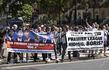 Newcastle fans protesting at Downing Street.Fans are staging a protest in the capital to back calls from would-be buyer Staveley and club owner Mike Ashley for transparency in the takeover arbitration process.The Public Investment Fund, Saudi Arabia's sovereign wealth fund, withdrew their backing for a proposed £300million deal last summer after the Premier League failed to make a timely decision on the deal.However, Ashley is attempting to resurrect the deal through arbitration - and he has Staveley's full support.