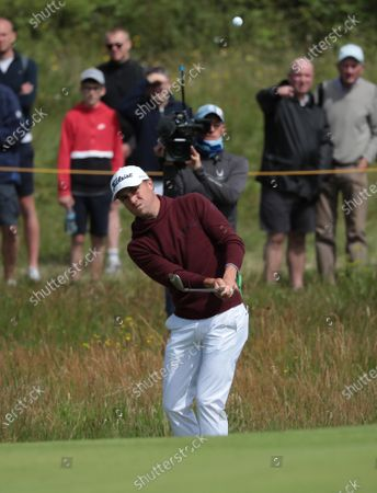 Justin Thomas of the USA chips onto the third green on day two of the Open Championship at Royal St George's in Sandwich, Kent on Friday, July 16, 2021.