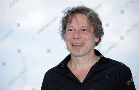 Mathieu Amalric poses during the photocall for 'Serre Moi Fort' (Hold Me Tight) at the 74th annual Cannes Film Festival, in Cannes, France, 16 July 2021. The festival runs from 06 to 17 July.