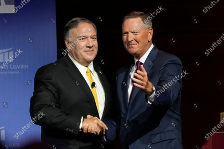 Former Secretary of State Mike Pompeo greets The Family Leader President Bob Vander Plaats, right, after speaking at the Family Leadership Summit, in Des Moines, Iowa
