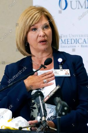 Dr. LouAnn Woodward, vice chancellor for health affairs and dean of the School of Medicine at the University of Mississippi Medical School, outlines the new COVID-19 vaccination policy that encourages all employees, students and anyone who works or learns in a UMMC facility or clinic to get fully vaccinated, or wear a N95 mask at all times, during a news conference in Jackson, Miss