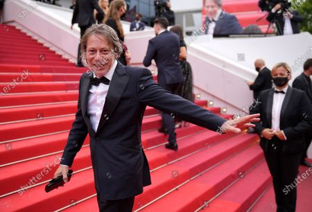 Mathieu Amalric poses for photographers upon arrival at the premiere of the film 'The Restless' at the 74th international film festival, Cannes, southern France