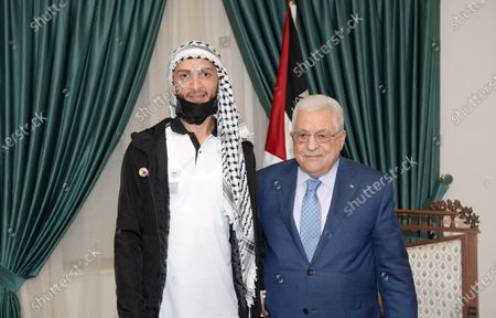 Editorial picture of Palestinian President Mahmoud Abbas meets with Ghazanfar Abu Atwan, a Palestinian man who was released from Israeli detention, at his headquarter in the West Bank city of Ramallah, Ramallah, West Bank, Palestinian Territory - 16 Jul 2021