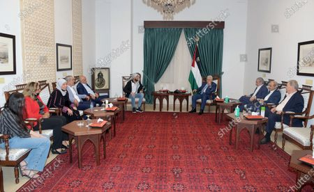 Stock Picture of Palestinian President Mahmoud Abbas meets with Ghazanfar Abu Atwan, a Palestinian man who was released from Israeli detention, at his headquarter in the West Bank city of Ramallah on July 16, 2021. Abu Atwan, who was arrested in October 2020, went on a hunger strike for more than 60 day.