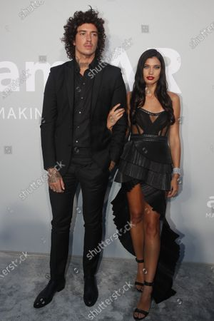 Stock Picture of Julian Perretta and Kambree Dalton (R) attend the Cinema Against AIDS amfAR gala 2021 held at the Hotel du Cap, Eden Roc in Cap d'Antibes, France, 16 July 2021, within the scope of the 74th annual Cannes Film Festival.