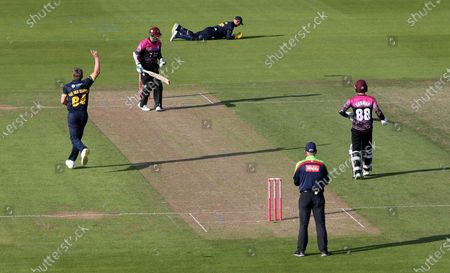 Stock Image of Steve Davies is caught by Chris Cooke of Glamorgan.