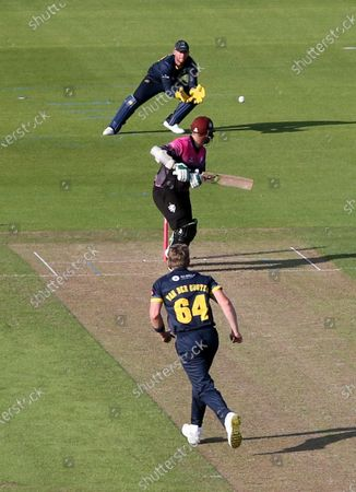 Steve Davies is caught by Chris Cooke of Glamorgan.