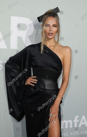 Natasha Poly poses for photographers upon arrival at the amfAR Cinema Against AIDS benefit the during the 74th Cannes international film festival, Cap d'Antibes, southern France