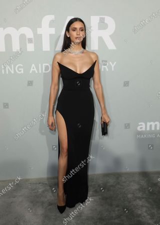 Nina Dobrev poses for photographers upon arrival at the amfAR Cinema Against AIDS benefit the during the 74th Cannes international film festival, Cap d'Antibes, southern France