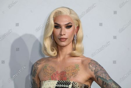 Miss Fame poses for photographers upon arrival at the amfAR Cinema Against AIDS benefit the during the 74th Cannes international film festival, Cap d'Antibes, southern France