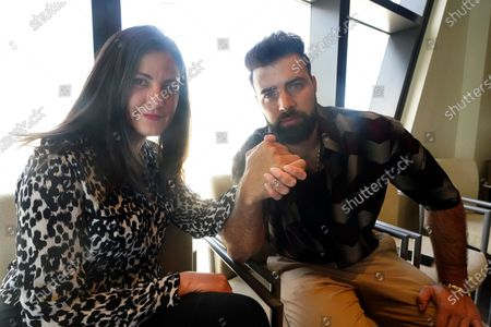 Cuban human rights activist Rosa Maria Paya, left, and Cuban-American actor/singer Jencarlos Canela pose for a photo after helping announce a rally, in Miami. The #SOSCuba rally will be held Saturday in front of Miami's iconic Freedom Tower
