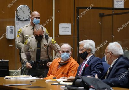 """Michael Thomas Gargiulo, left, listens to his defense attorneys Daniel Nardoni, middle, and Dale Michael Rubin, right, during his sentencing hearing at Los Angeles Superior Court, . A judge denied a new trial for Garigiulo, a man prosecutors called """"The Boy Next Door Killer,"""" who could be sentenced to death later Friday for the home-invasion murders of two women and the attempted murder of a third"""