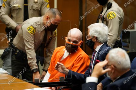"""Michael Thomas Gargiulo, left, listens to his defense attorneys, Daniel Nardoni, middle, and Dale Michael Rubin during a sentencing hearing at Los Angeles Superior Court, . A judge denied a new trial for Garigiulo, a man prosecutors called """"The Boy Next Door Killer,"""" who could be sentenced to death later Friday for the home-invasion murders of two women and the attempted murder of a third"""
