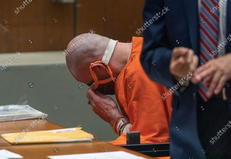 """Michael Thomas Gargiulo adjusts his face mask during a sentencing hearing at Los Angeles Superior Court, . Gargiulo has pleaded not guilty to two counts of murder and an attempted-murder charge stemming from attacks in the Los Angeles area between 2001 and 2008, including the death of Kutcher's former girlfriend, 22-year-old Ashley Ellerin. A judge denied a new trial for Garigiulo, a man prosecutors called """"The Boy Next Door Killer,"""" who could be sentenced to death later Friday for the home-invasion murders of two women and the attempted murder of a third"""