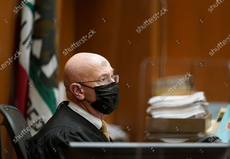 Los Angeles Superior Court Judge Larry P. Fidler wears a face mask during the sentencing hearing of Michael Thomas Gargiulo at Los Angeles Superior Court, . The judge denied a new trial for Gargiulo, who could be sentenced to death later Friday for the home-invasion murders of two women and the attempted murder of a third. Judge Larry Fidler rejected a defense motion arguing there was not enough physical evidence against 45-year-old Gargiulo