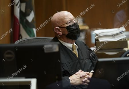 """Los Angeles Superior Court Judge Larry P. Fidler listens to victim's statements before the sentencing hearing of Michael Thomas Gargiulo, at Los Angeles Superior Court, . Judge Larry P. Fidler gave a death sentence to Michael Gargiulo, who prosecutors called """"The Boy Next Door Killer"""" for the home-invasion murders of two women and the attempted murder of a third"""