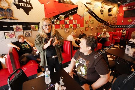 Singer Melissa Etheridge (L) talks with customer Debbie Sexton before having lunch at Cathy's Kitchen in Ferguson, Missouri on Friday, July 16, 2021. Etheridge, who is friends with Cathy Jenkins is having lunch at the small restaurant on the first day that the dining room is reopened. Cathy's Kitchen has been closed to the public for over a year due to the pandemic and became nationally known after protesters vandalized her business during the Michael Brown events of 2014.