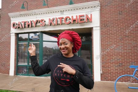 Business owner Cathy Jenkins stands in front of Cathy's Kitchen in Ferguson, Missouri on Friday, July 16, 2021. Jenkins has reopened the small dining room to the public after being closed for over a year due to the pandemic. Jenkins became nationally known after protesters vandalized her business during the Michael Brown events of 2014.