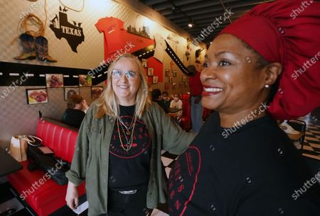 Stock Image of Singer Melissa Etheridge (L)  talks with Cathy Jenkins at Cathy's Kitchen in Ferguson, Missouri on Friday, July 16, 2021. Etheridge, who is friends with Jenkins is having lunch at the small restaurant on the first day that the dining room is reopened. Cathy's Kitchen has been closed to the public for over a year due to the pandemic and became nationally known after protesters vandalized her business during the Michael Brown events of 2014.