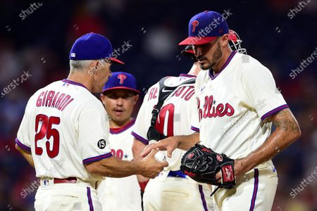 Stock Picture of Philadelphia Phillies starting pitcher Zach Eflin, right, is removed by manager Joe Girardi (25) during the fourth inning of the second baseball game of the team's doubleheader against the Miami Marlins, in Philadelphia