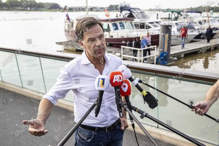 Dutch Prime Minister Mark Rutte speaks to press in Venlo, the Netherlands, 16 July 2021. Heavy rainfall has led to floods in various parts of the Netherlands and central Europe