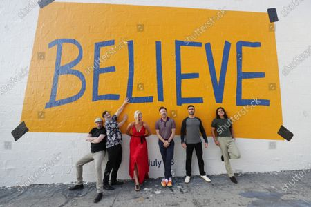 """Stock Picture of : Apple's """"Ted Lasso"""" stars Brett Goldstein, Jeremy Swift, Hannah Waddingham, Jason Sudeikis, Brendan Hunt and Cristo Fernandez make a surprise visit to the """"Believe"""" wall art on Los Angeles' Melrose Avenue at Ogden where fans of the multiple Emmy-nominated comedy phenomenon are flocking to take photos ahead of the season two premiere, Friday, July 23 on Apple TV+."""