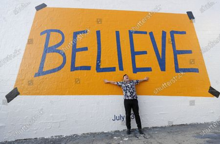 """: Apple's """"Ted Lasso"""" stars Jeremy Swift make a surprise visit to the """"Believe"""" wall art on Los Angeles' Melrose Avenue at Ogden where fans of the multiple Emmy-nominated comedy phenomenon are flocking to take photos ahead of the season two premiere, Friday, July 23 on Apple TV+."""