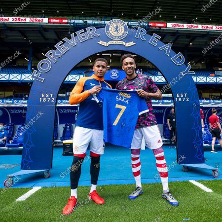 Rangers captain James Tavernier presents Arsenal captain Pierre-Emerick Aubameyang a shirt for Bukayo Saka at the pre season friendly match at Ibrox Stadium, Glasgow.