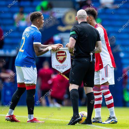 Rangers captain James Tavernier and Arsenal's Pierre-Emerick Aubameyang exchange pennants during the pre season friendly match at Ibrox Stadium, Glasgow.