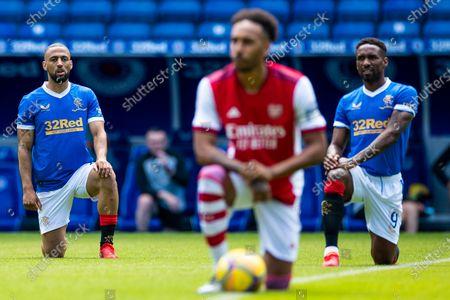 Kemar Roofe and Jermain Defoe of Rangers and Arsenal's Pierre-Emerick Aubameyang kneel during the pre season friendly match at Ibrox Stadium, Glasgow.