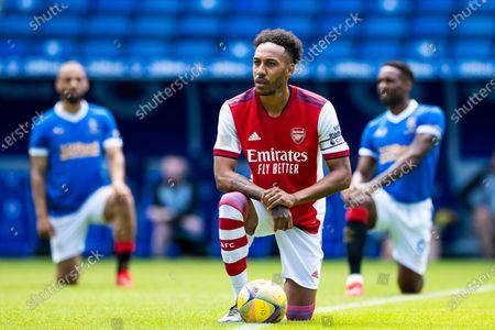 Arsenal's Pierre-Emerick Aubameyang takes a knee during the pre season friendly match at Ibrox Stadium, Glasgow.
