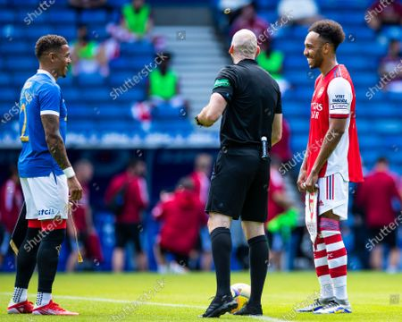 Rangers captain James Tavernier and Arsenal's Pierre-Emerick Aubameyang during the coin toss at the start of the pre season friendly match at Ibrox Stadium, Glasgow.