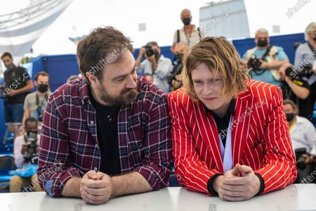 Director Justin Kurzel, left, and Caleb Landry Jones pose for photographers at the photo call for the film 'Nitram' at the 74th international film festival, Cannes, southern France